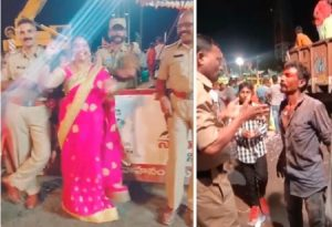 drunken youth makes hulchal with police men in ganesh nimajjanam at tank bund