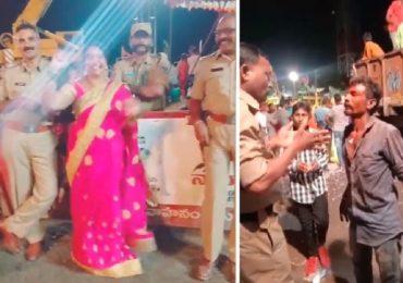 drunken youth makes hulchal with police men in ganesh nimajjanam at tank bund